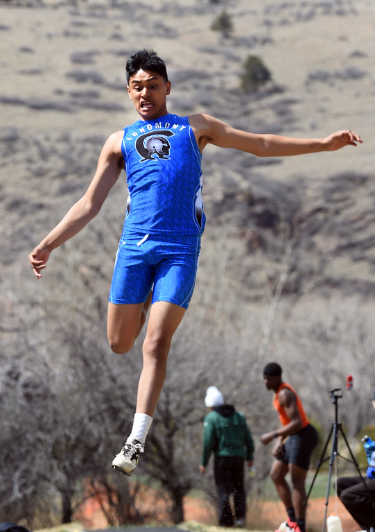 . David Hernandez, of Longmont, competes in the long jump during the Lyons Invitational track meet on Saturday. For more photos, go to BoCoPreps.com. Cliff Grassmick  Photographer  March 31, 2018