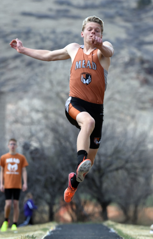 . Bryson Tillema, of Mead, competes in the long jump during the Lyons Invitational track meet on Saturday. For more photos, go to BoCoPreps.com. Cliff Grassmick  Photographer  March 31, 2018