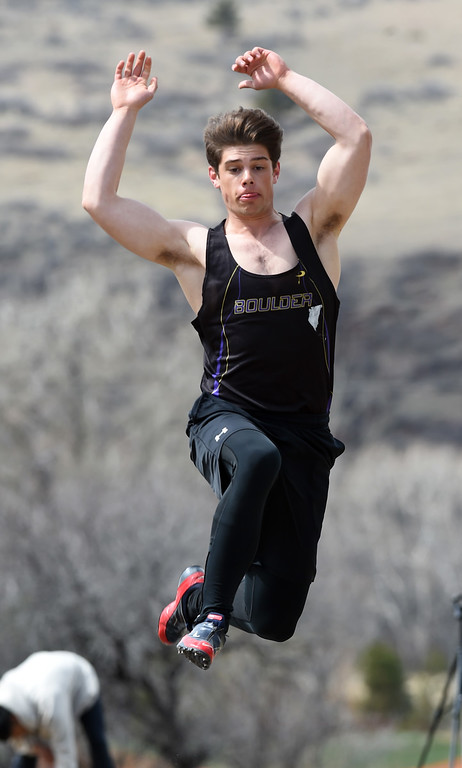 . David Young, of Boulder, competes in the long jump during the Lyons Invitational track meet on Saturday. For more photos, go to BoCoPreps.com. Cliff Grassmick  Photographer  March 31, 2018