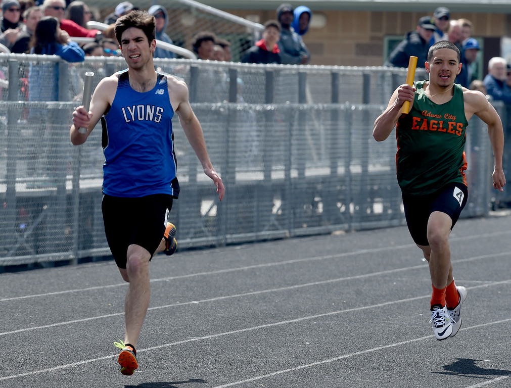 . Nathan Radich, of Lyons, runs in the 4X200 meter relay during the Lyons Invitational track meet on Saturday. For more photos, go to BoCoPreps.com. Cliff Grassmick  Photographer  March 31, 2018