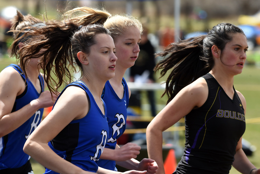 . Ivy Gonzales, left, of Broomfield, competes in the 1600 meters during the Lyons Invitational track meet on Saturday. For more photos, go to BoCoPreps.com. Cliff Grassmick  Photographer  March 31, 2018