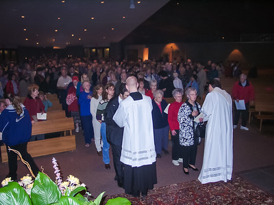 Fr. Kaz Chwalek and Deacon bless attendees with a relic of St. Faustina. Sterling Heights, MI, 700 in attendance.