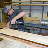 Chad Thrasher putting together one of many mantels