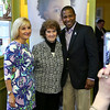 The March of Dimes held a Kick off reception for this falls Signature Chef Auction, and announcement of this year's honoree, local artist Janet Lambert Moore, was held at Ricardo's Restaurant in Lowell on Monday night. Honoree Moore, center, poses for a picture with Sue Zacharer and Brian Chapman the co-chairmen of the event. SUN/JOHN LOVE