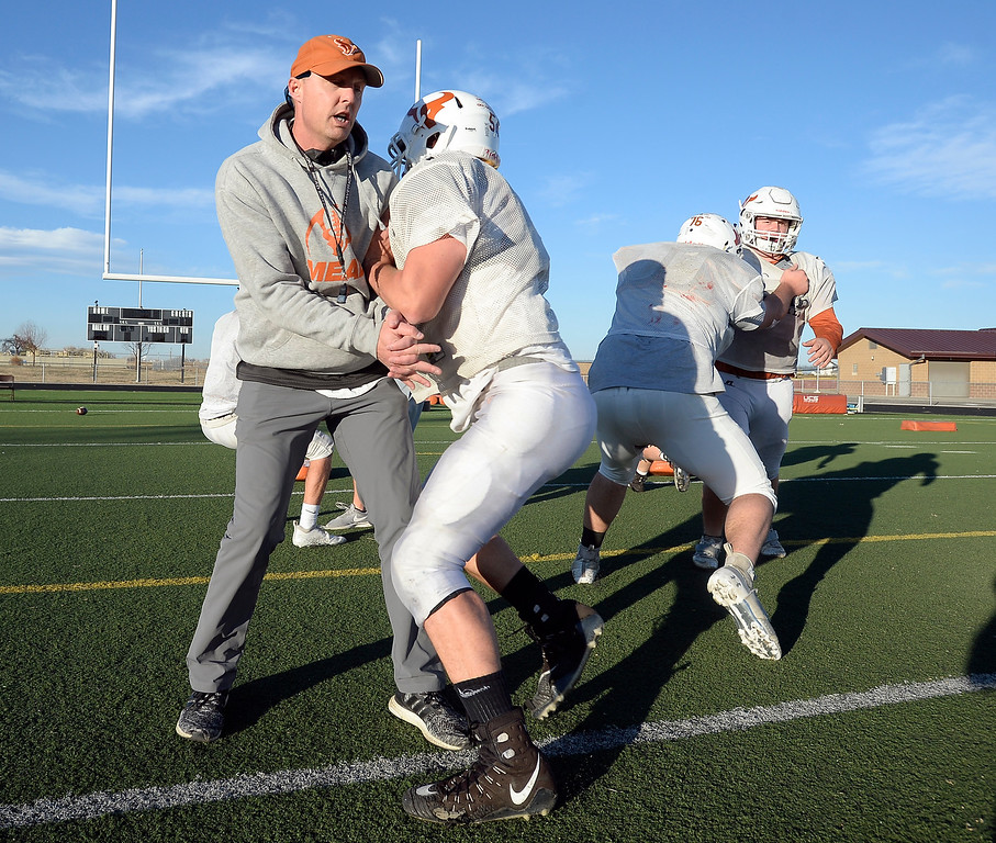 . MEAD, CO: November 15: Mead head coach, Jason Platt, gets involved in the O-line drills with Marcel Macphail during practice.The Mead High School Football team practice on Thursday before it heads to Palisade for its quarterfinals game. (Photo by Cliff Grassmick/Staff Photographer)