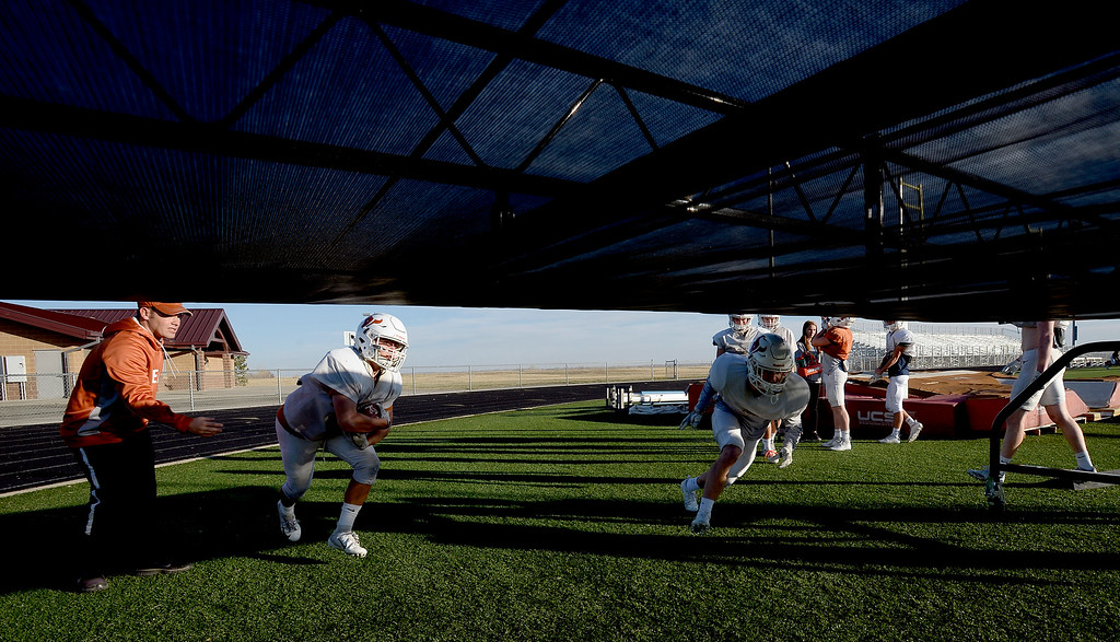 . MEAD, CO: November 15: Mead running backs practice getting low. The Mead High School Football team practice on Thursday before it heads to Palisade for its quarterfinals game. (Photo by Cliff Grassmick/Staff Photographer)