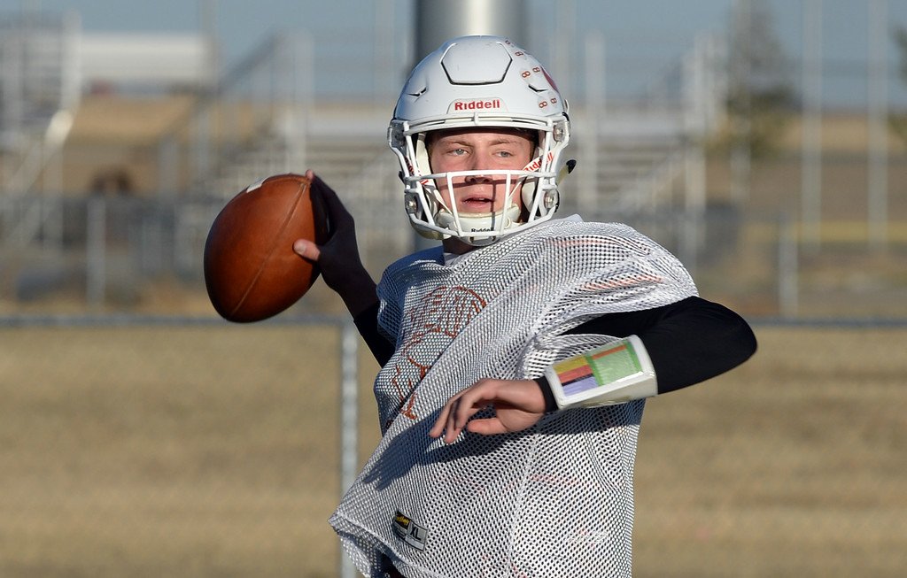 . MEAD, CO: November 15:  Maverick quarterback, Brady Veltien, throws a pass during practice. The Mead High School Football team practice on Thursday before it heads to Palisade for its quarterfinals game. (Photo by Cliff Grassmick/Staff Photographer)