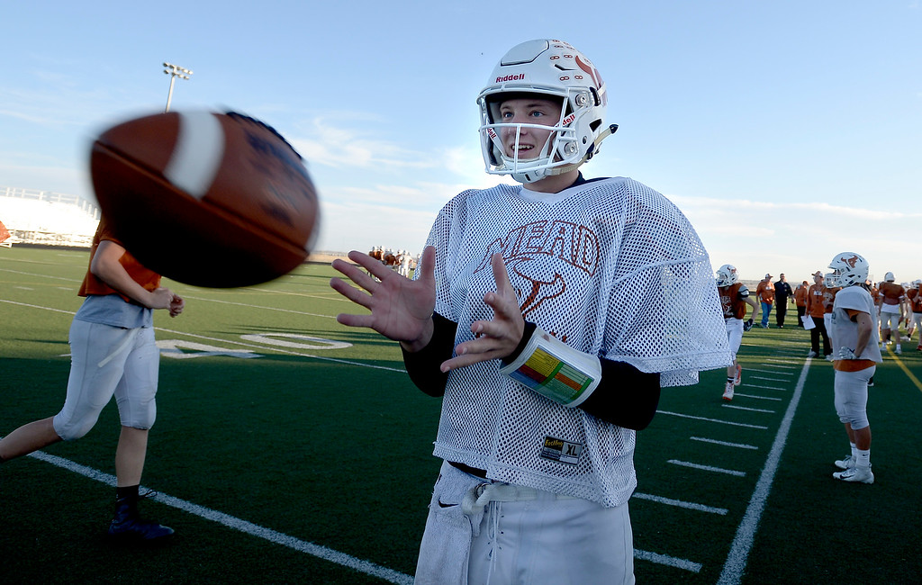 . MEAD, CO: November 15:  Maverick quarterback, Brady Veltien, catches a pass during practice. The Mead High School Football team practice on Thursday before it heads to Palisade for its quarterfinals game. (Photo by Cliff Grassmick/Staff Photographer)
