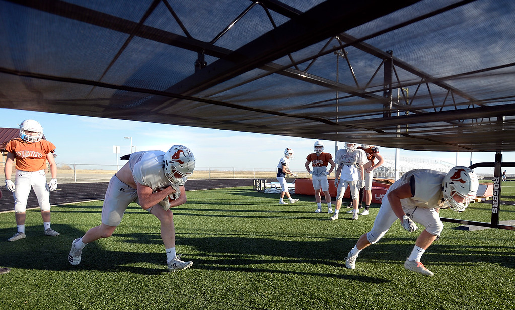 . MEAD, CO: November 15: Devin Edwards, left, and Caleb Deminico, get low during running back drills. The Mead High School Football team practice on Thursday before it heads to Palisade for its quarterfinals game. (Photo by Cliff Grassmick/Staff Photographer)