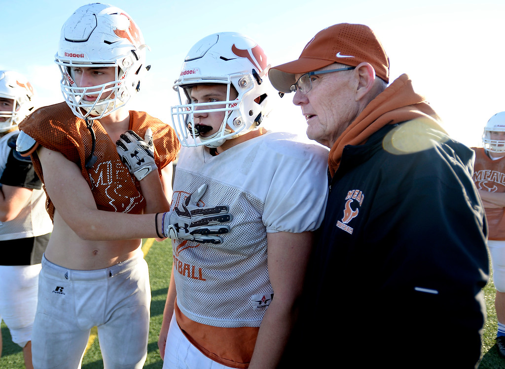 . MEAD, CO: November 15: Jay Olson, left, and Bryce Schmidt, talk with assistant coach, Gary Klatt, at practice.  The Mead High School Football team practice on Thursday before it heads to Palisade for its quarterfinals game. (Photo by Cliff Grassmick/Staff Photographer)