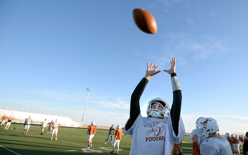 . MEAD, CO: November 15:  Maverick quarterback, Brady Veltien, catches a pass during practice.The Mead High School Football team practice on Thursday before it heads to Palisade for its quarterfinals game. (Photo by Cliff Grassmick/Staff Photographer)