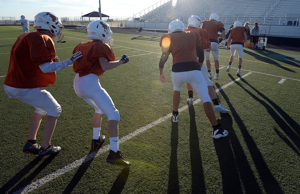 . MEAD, CO: November 15:  Defensive players run in drills at practice.The Mead High School Football team practice on Thursday before it heads to Palisade for its quarterfinals game. (Photo by Cliff Grassmick/Staff Photographer)