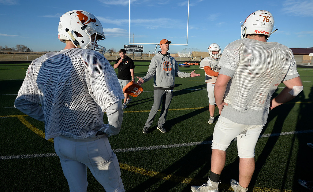 . MEAD, CO: November 15: Mead head coach, Jason Klatt, talks to his offensive line. The Mead High School Football team practice on Thursday before it heads to Palisade for its quarterfinals game. (Photo by Cliff Grassmick/Staff Photographer)