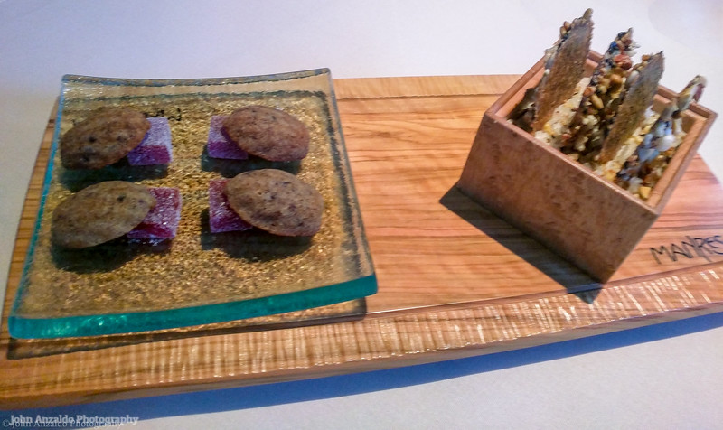 Petit fours red pepper black olive and Granola crisp