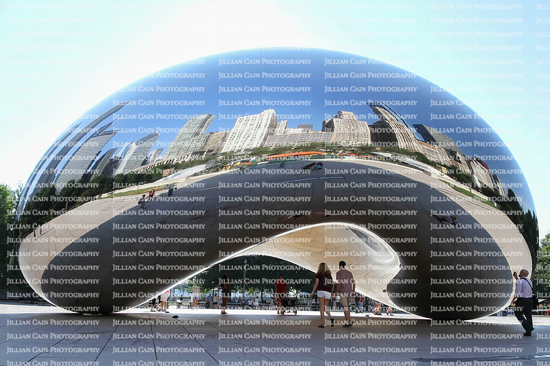 """EDITORIAL USE ONLY:    Tourist and visitors interact with """"The Bean"""" aka """"Cloud Gate"""" a popular tourist attraction at Millennium Park in downtown Chicago."""