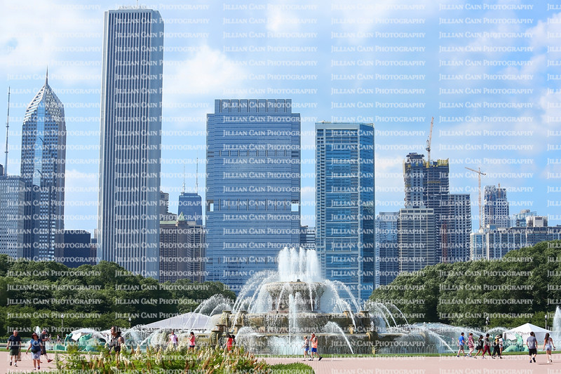 Chicago skyline with Buckingham Fountain in the foreground being enjoyed by tourist on a summer day.