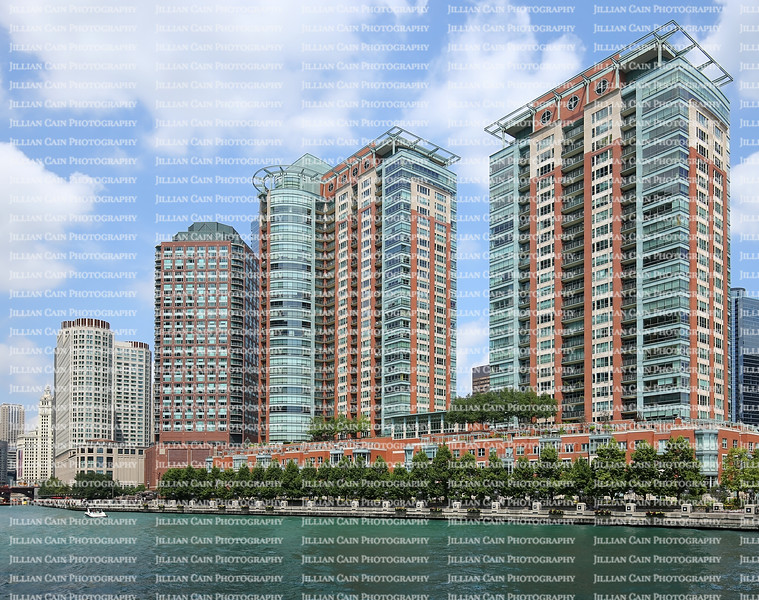 Water view of Chicago Riverwalk lined with rows of condominiums and beautiful landscaping.