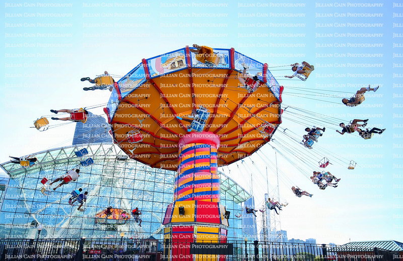 EDITORIAL USE ONLY:    Adults and kids scream as the Navy Pier Wave Swinger Ride spins them into the air.