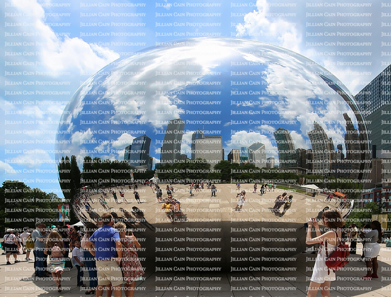CHICAGO, ILLINOIS, USA:  People interact with the their reflections in the Bean sculpture aka Cloud Gate, popular tourist attraction at Millennium Park in downtown Chicago as seen on July 1, 2018.