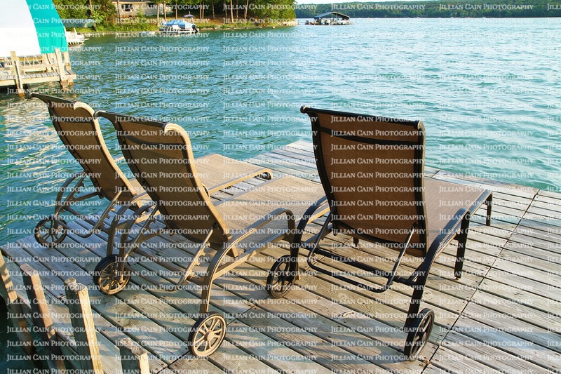 Lounge chairs on a beautiful lake front dock