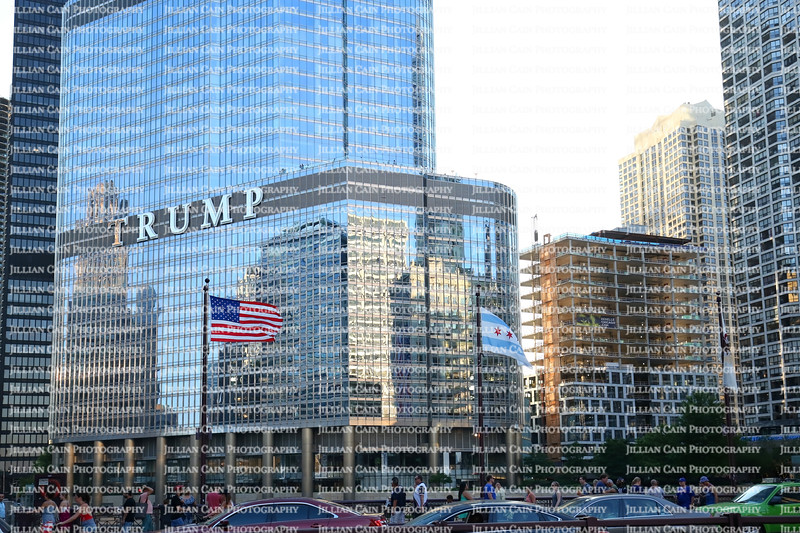 The American flags fly's proudly in front of the Trump International Hotel & Tower in downtown Chicago.  It's the 4th tallest building in the USA.