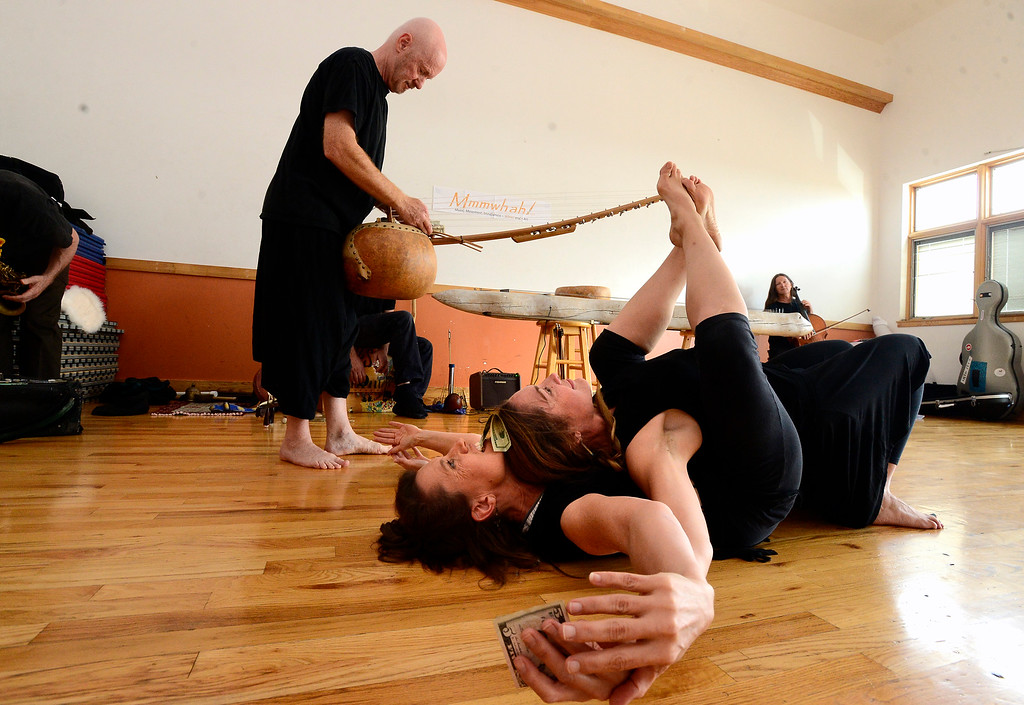 ". Merlyn Holmes, bottom, Amy Biondo and Bill McCrossen of the Mmmwhah! Ensemble practice the piece ""Transform\"" at the Boulder Circus Center on Wednesday September 19, 2018. They will perform \""Transform\"" at The Bustop in North Boulder on Saturday September 29. Housing and arts space are slated to replace the 42-year-old strip club. (Photo by Paul Aiken/Staff Photographer)"
