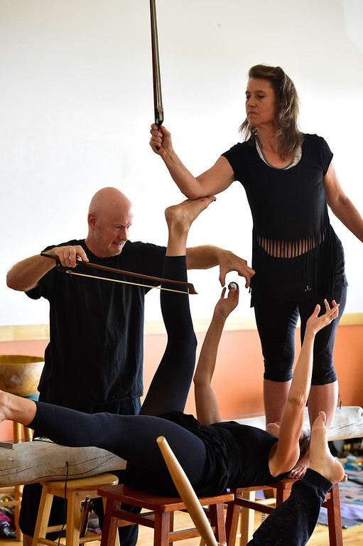 ". From left to right Bill McCrossen, Amy Biondo, and Merlyn Holmes of the Mmmwhah! Ensemble practice the piece ""Transform\"" at the Boulder Circus Center on Wednesday September 19, 2018. They will perform \""Transform\"" at the Bustop in North Boulder on Saturday September 29. Housing and arts space are slated to replace the 42-year-old strip club. (Photo by Paul Aiken/Staff Photographer)"
