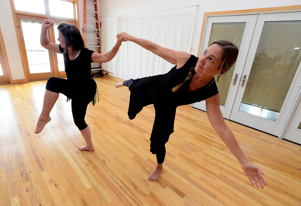 ". Merlyn Holmes, left, Amy Biondo of the Mmmwhah! Ensemble practice the piece ""Transform\"" at the Boulder Circus Center on Wednesday September 19, 2018. They will perform \""Transform\"" at The Bustop in North Boulder on Saturday September 29. Housing and arts space are slated to replace the 42-year-old strip club. (Photo by Paul Aiken/Staff Photographer)"