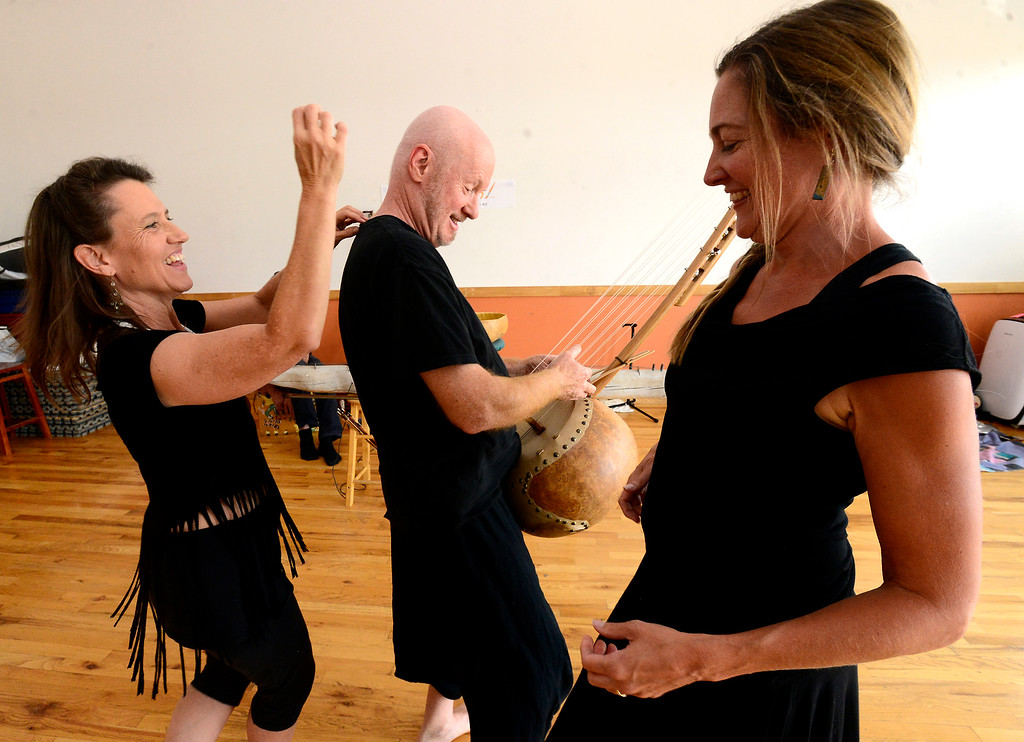 ". Merlyn Holmes, left, Bill McCrossen and Amy Biondo of the Mmmwhah! Ensemble practice the piece ""Transform\"" at the Boulder Circus Center on Wednesday September 19, 2018. They will perform the dance at The Bustop in North Boulder on Saturday September 29. Housing and arts space are slated to replace the 42-year-old strip club. For more photos go to dailycamera.com. (Photo by Paul Aiken/Staff Photographer)"
