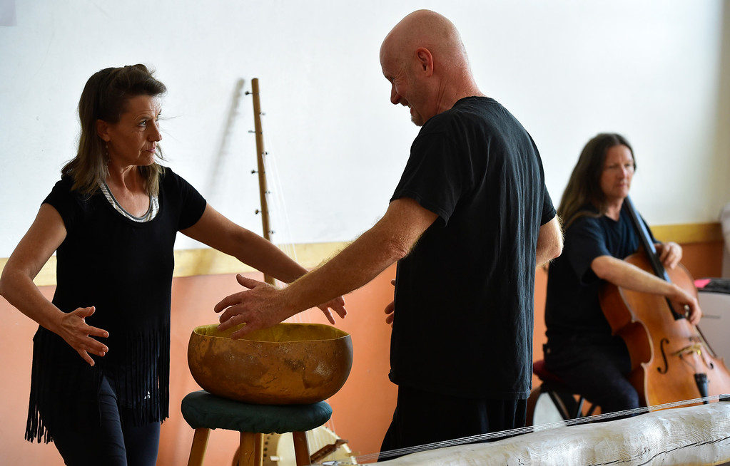 ". Merlyn Holmes, Bill McCrossen and  James Hoskins of the Mmmwhah! Ensemble practice the piece ""Transform\"" at the Boulder Circus Center on Wednesday September 19, 2018. They will perform \""Transform\"" at The Bustop in North Boulder on Saturday September 29. Housing and arts space are slated to replace the 42-year-old strip club. (Photo by Paul Aiken/Staff Photographer)"