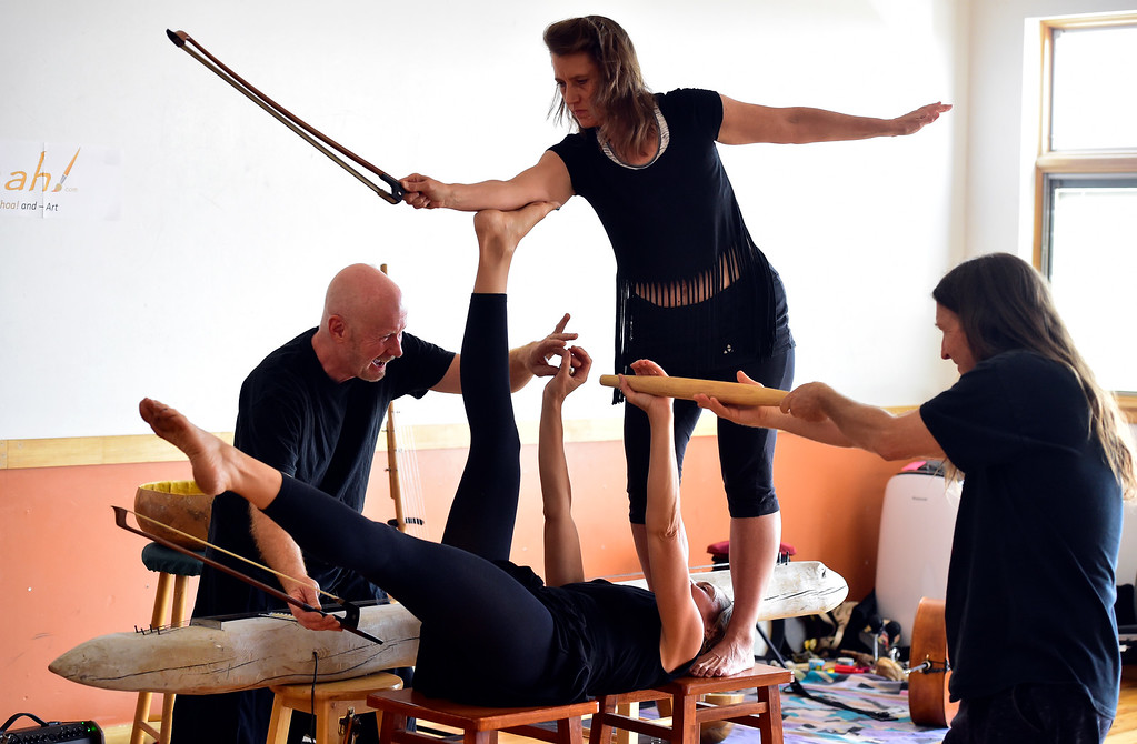 ". From left to right Bill McCrossen, Amy Biondo, Merlyn Holmes and James Hoskins of the Mmmwhah! Ensemble practice the piece ""Transform\"" at the Boulder Circus Center on Wednesday September 19, 2018. They will perform the dance at the Bustop in North Boulder on Saturday September 29. Housing and arts space are slated to replace the 42-year-old strip club. (Photo by Paul Aiken/Staff Photographer)"