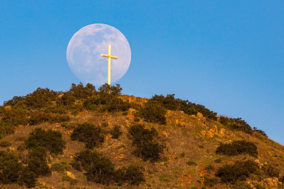 Nearly Full Moon Rises Above Battle Mountain Cross