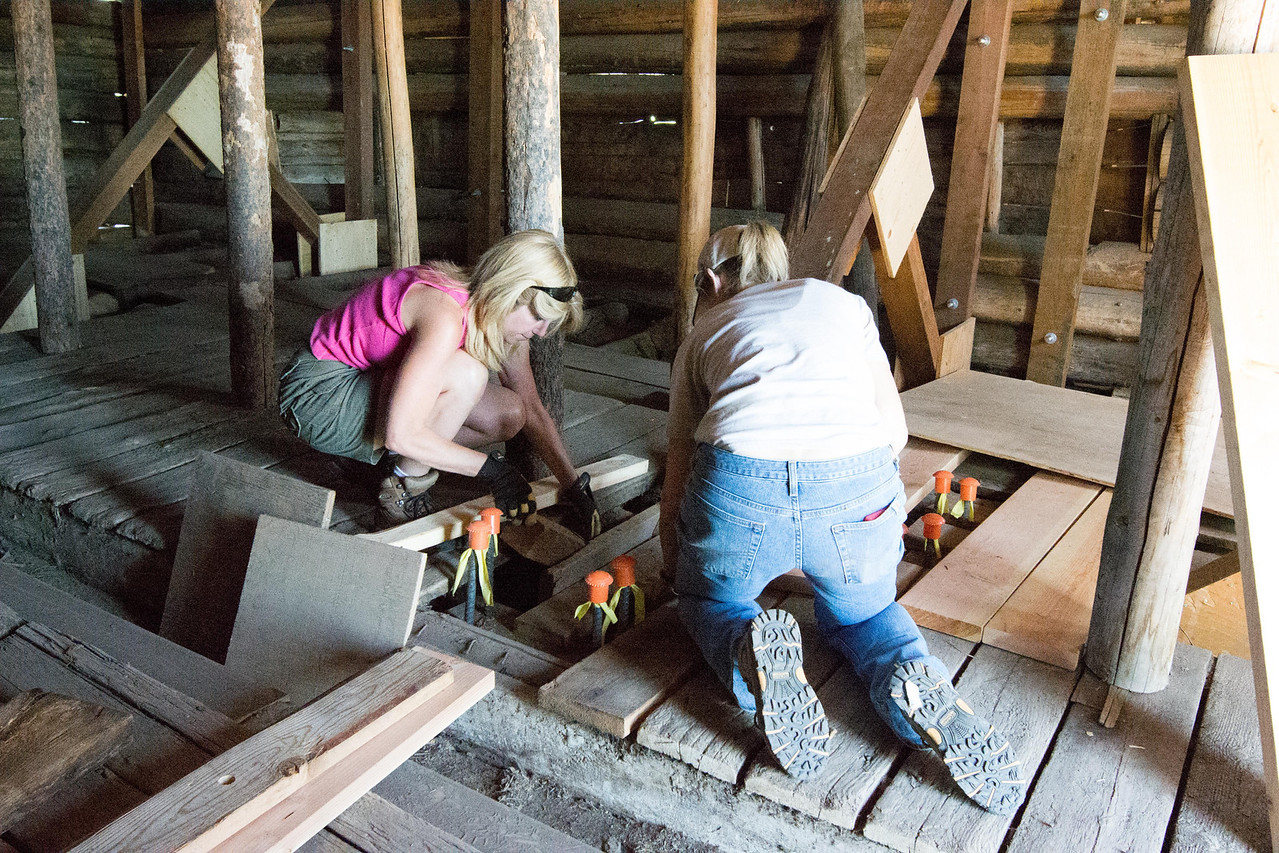 Volunteers working on the interior of the Barn.