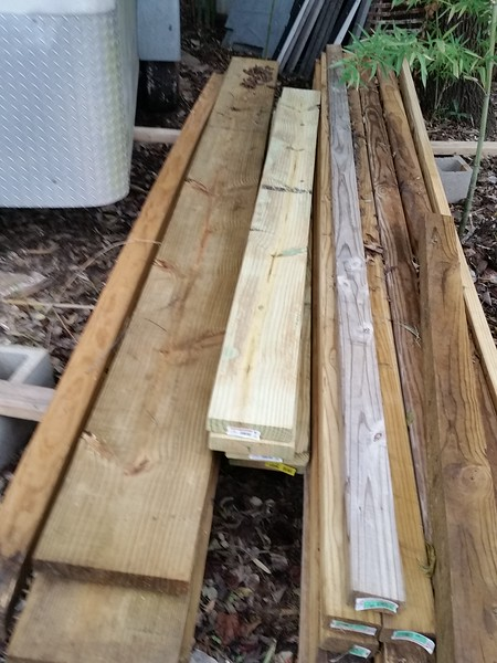 """Fresh """"retail"""" pressure treated 2 x 8's in the center."""
