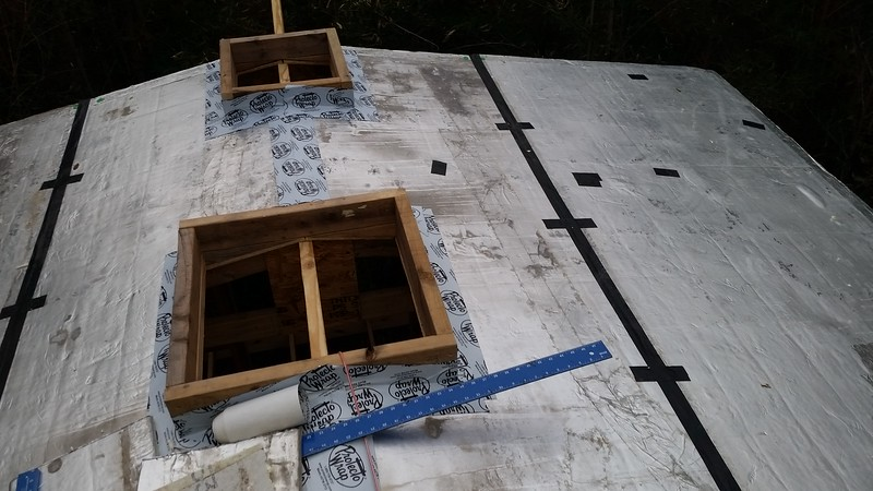 R-max down, curbs for exhaust fan and 1 of 4 skylights
