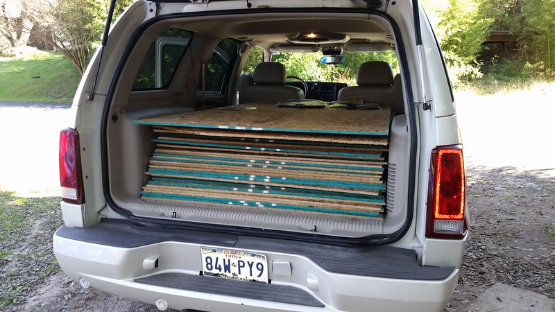 """Found 34 - 48×41 pieces of 7/16"""" OSB for roof decking - even a half size sheet is still about 30 lb. I would have had to cut them all in two  anyway if I had gotten full sheets.  That's about 600 lbs and the truck was riding on the stops all the way home.  60 bucks on Craigslist. Pretty cheap."""