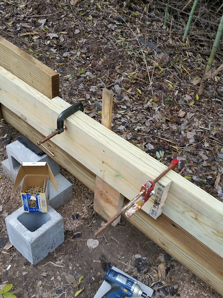 """Temporary clamps to assure a good """"friction"""" joint between the pieces while I put 9 2-1/2"""" screws into the boards. After all is in place, there will be 6 more screws into the boards from the opposite side."""
