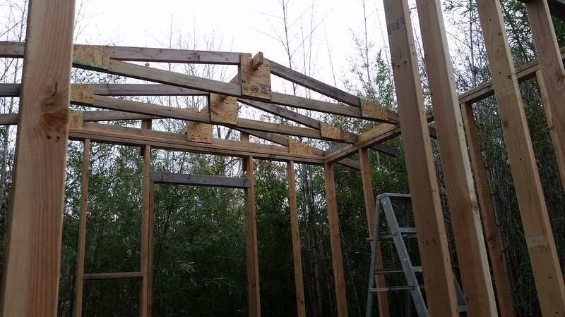 Three of the roof joists were built with a slot in the center to accept a 2×6 cantilever beam over the back porch. Just for proper alignment and positioning I used a 2×4..
