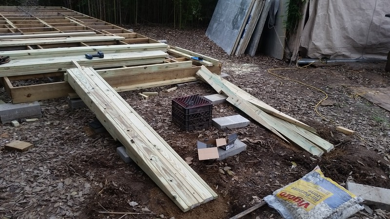 2×4×8' boards screwed into sides of 2×6 beams to add stiffness