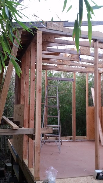Temporary scaffolding required to trim joists, seal walls to roof, apply siding, etc.
