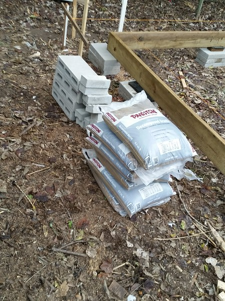 Each footing/support is dug out to raw ground, decomposed granite applied and compacted and leveled. 18 bags used. Those damned 0.50 cubic foot bags of decomposed granite weigh about 60 pounds and cost about $4.50. Bulk granite is $44 per cubic yard. Nice profit, HD..................