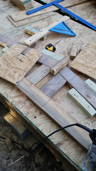 The ends of the garage will have an overhang so 4 or 5 of the joists have cutouts to accommodate a cantilevered beam.