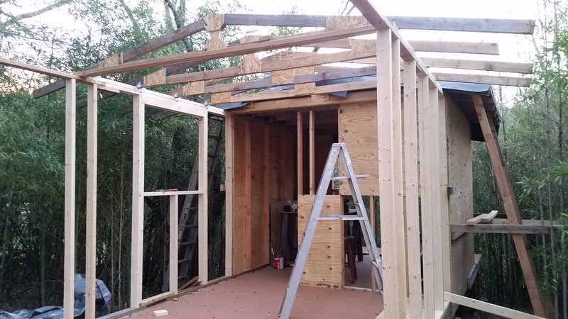 First Window framed in - using 4 segments of two damaged windows for 4 fixed pane windows in garage area.