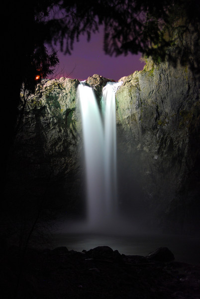 Snoqualmie Falls in the foothils of the Cascade Mountains in Washington is a beautiful place at night. Some very faint lights illuminate the falls allowing for some beautiful long-exposure night photography.