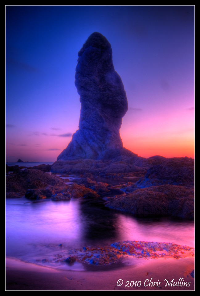The sun sets at Point of the Arches, in Olympic National Park. What symbolism does this sea stack evoke for you?