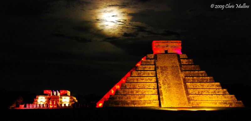 The lightshow at the Mayan Ruins of Chichen Itza is stunning in it's beauty. Here the full moon peaks out and adds it's own mystery to the scene.