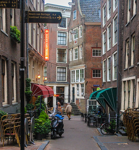 Many of Amsterdam's streets are old, tightly packed and were never designed for cars. It was so much fun just to walk along them and study a lifestyle so foreign to big cities in western America. Our main Globus tour Guide, Paul, is in the brown coat. It was pretty cool there most of the time.