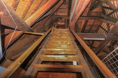 These tricky steps up to the windmill's highest deck were only about 20 degrees off of full vertical, with shallow step boards and 2 near-worthless handrails set at ankle height. This ladder design is typical. Only 3 of us braved the journey up into the cap shell.