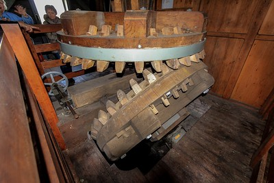 The windmill's wooden drive train is massive and very dense wood makes up the gear teeth. Rookie operators are warned to never engage the windshaft with the sails turning or you will rip the wooden teeth to shreds-a nasty repair.