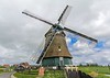 We toured this all wood, all manual windmill near Volendam, Holland. It is built on a 400 year old design. Sails are adjusted by ropes. The sail brake is deployed using a rope that releases a weighted tensioner. Even the entire top section is manually spun around to face the wind using a leverage wheel called a winder.